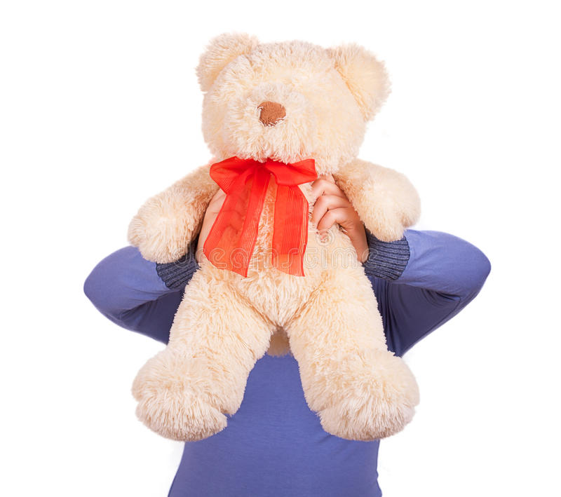 Woman holds up a teddy bear stock photography