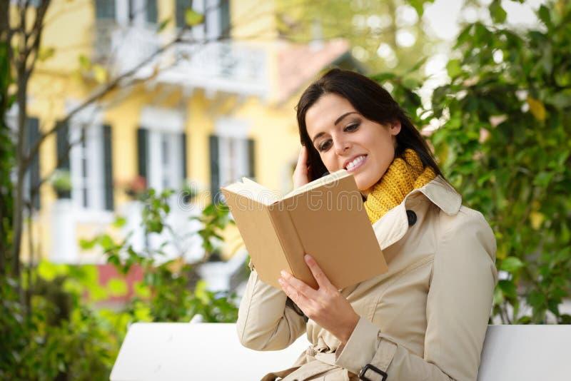 Woman at home garden reading book stock photo
