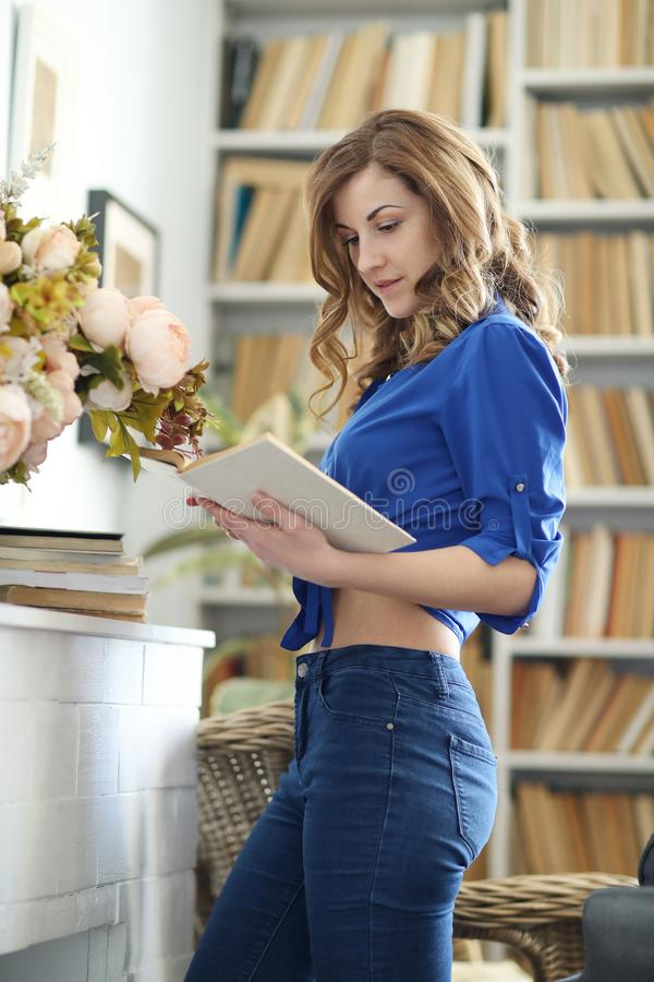 Woman at home. Lovely girl at home during the day stock photo