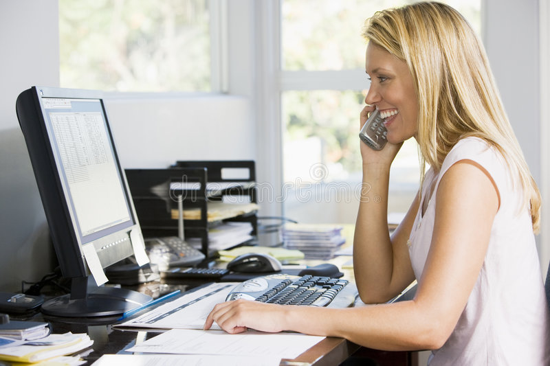 Download Woman In Home Office With Computer Using Telephone Royalty Free Stock Photo - Image: 5932245