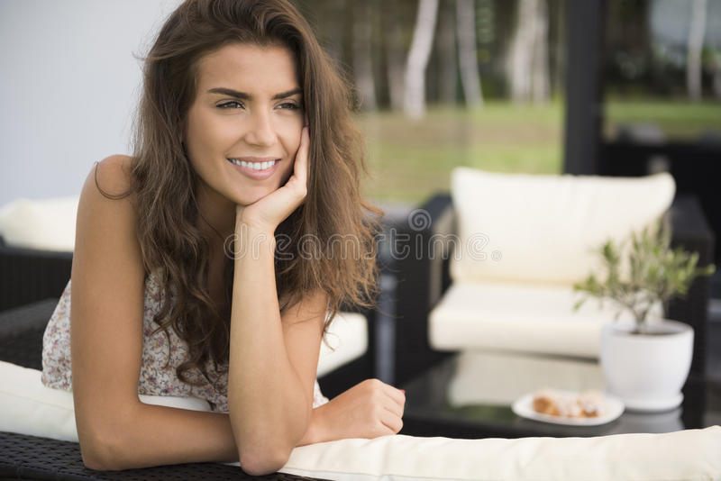 Woman at home terrace stock photo