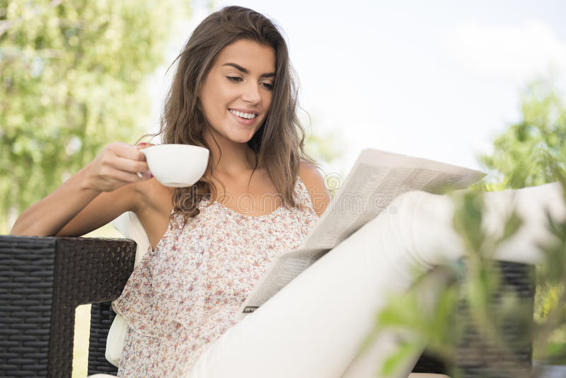Woman at home terrace stock photography