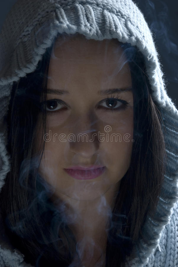 Download Woman With Hood In Smoke Stock Image - Image: 12085701
