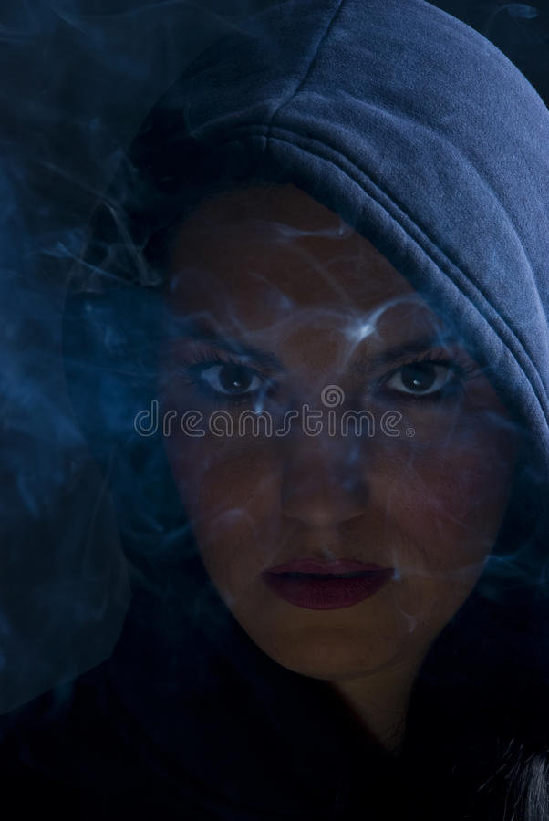 Free Woman Hooded In Darkness With Smoke Royalty Free Stock Photography - 12008487