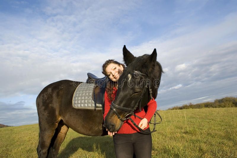 Download A woman and a horse. stock photo. Image of friendship - 12587110