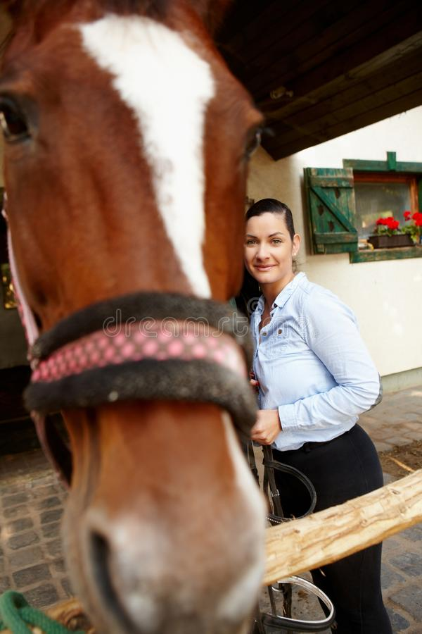 Woman and horse best friends stock photo