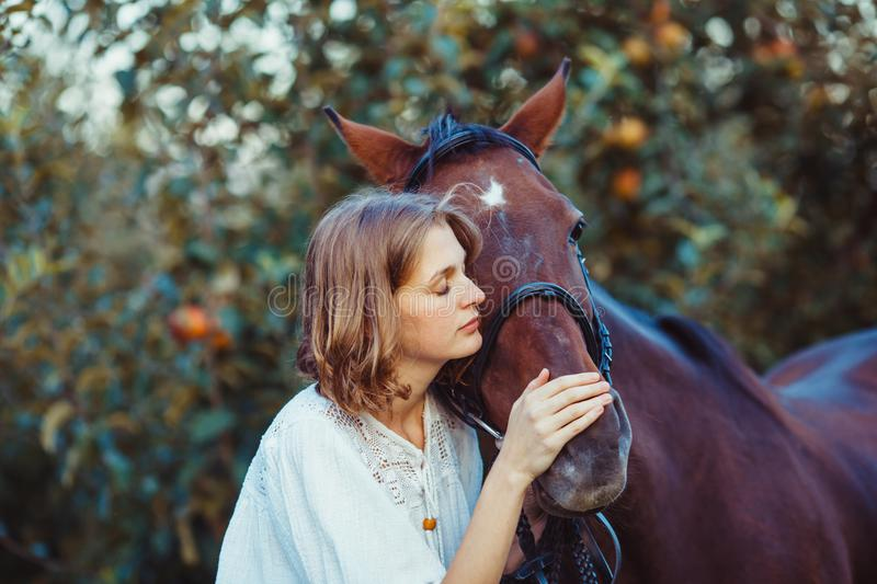 Woman and horse. Romantic woman portrait with the horse. Dreaming with best friend royalty free stock image