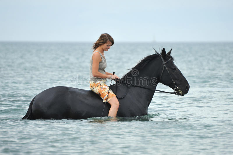 Download Woman And  Horse In The Sea Stock Image - Image of beach, evening: 18385373