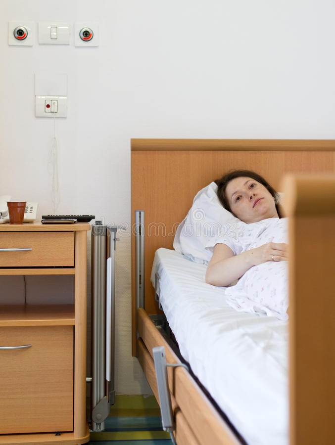 Woman in hospital room royalty free stock photo