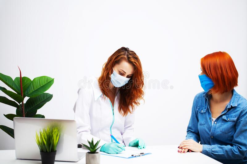 Woman at the hospital submits a blood test for a coronavirus. Woman at the hospital submits a blood test for a coronavirus royalty free stock photos