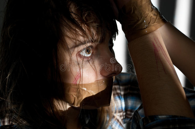 Woman hostage stock image