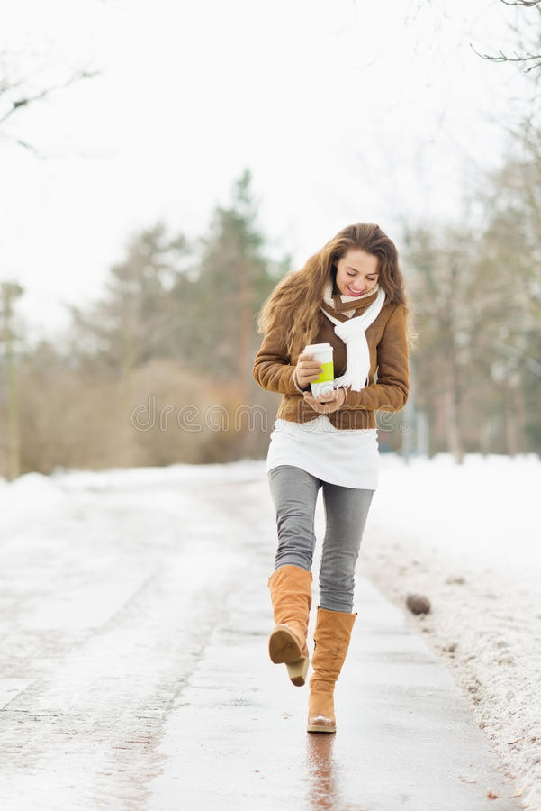 Download Woman With Hot Beverage Walking In Winter Park Stock Photo - Image: 29129070