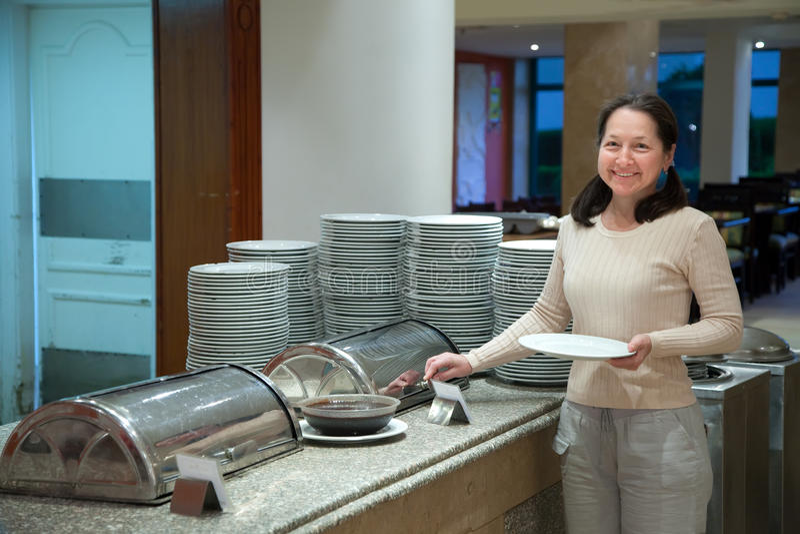 Woman at hotel buffet stock photo