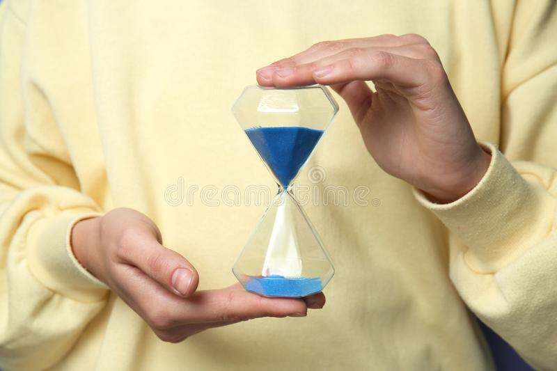 Woman with hourglass, closeup royalty free stock images