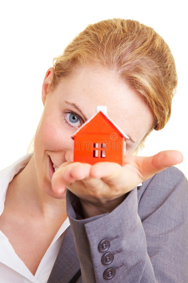 Woman and house. Real estate broker holding a miniature house stock images