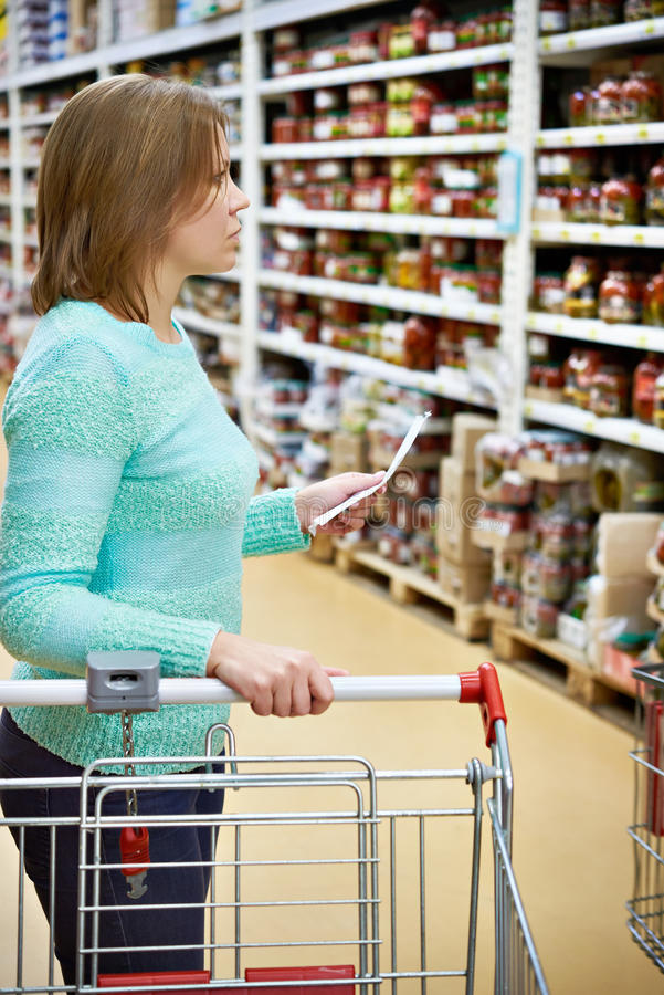 Woman housewife with list shopping in shop. Woman housewife with list shopping in supermarket royalty free stock images