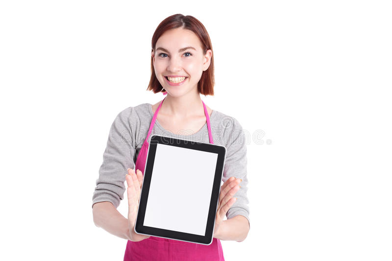 Woman housewife with tablet pc. Young woman housewife mother wearing kitchen apron show digital tablet pc with empty screen, isolated on white background royalty free stock photo