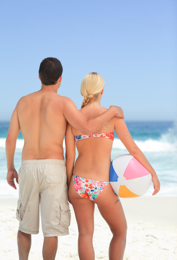 Download Woman Hugging Her Husband On The Beach Stock Image - Image: 18701247