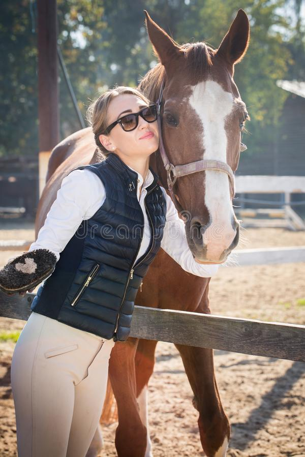 Woman hugging a horse. Young beautiful woman communicates with a horse stock photos