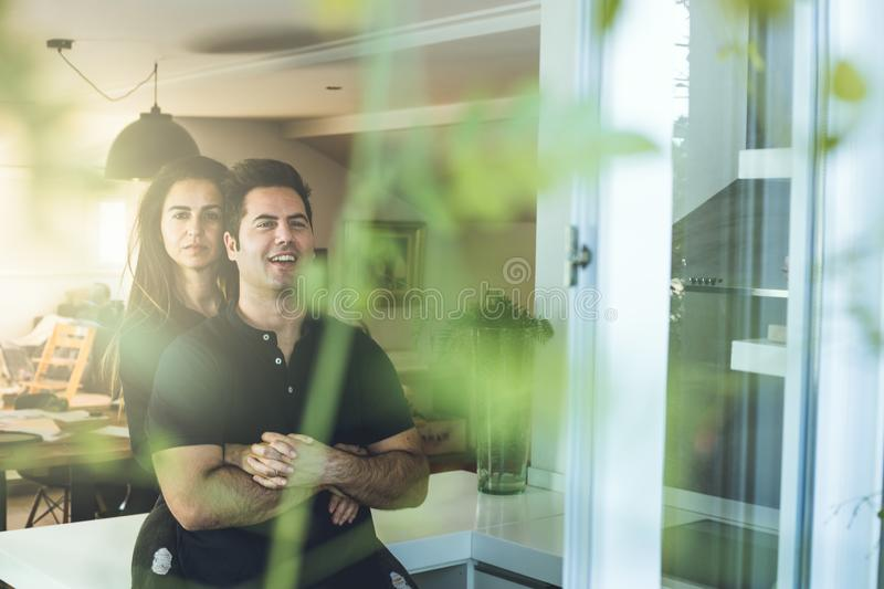 Woman hugging a man at home. Romantic concept of love and affection between couples. A women hugging a men at home. Romantic concept of love and affection stock photos