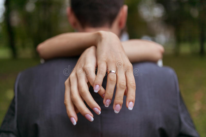 Woman hugging a man in the park stock image