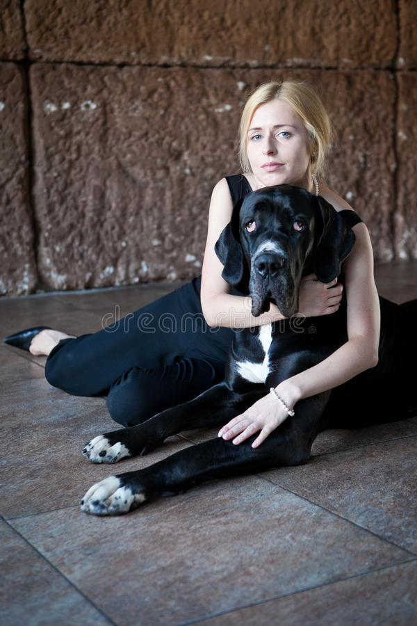 Woman hugs a dog stock images