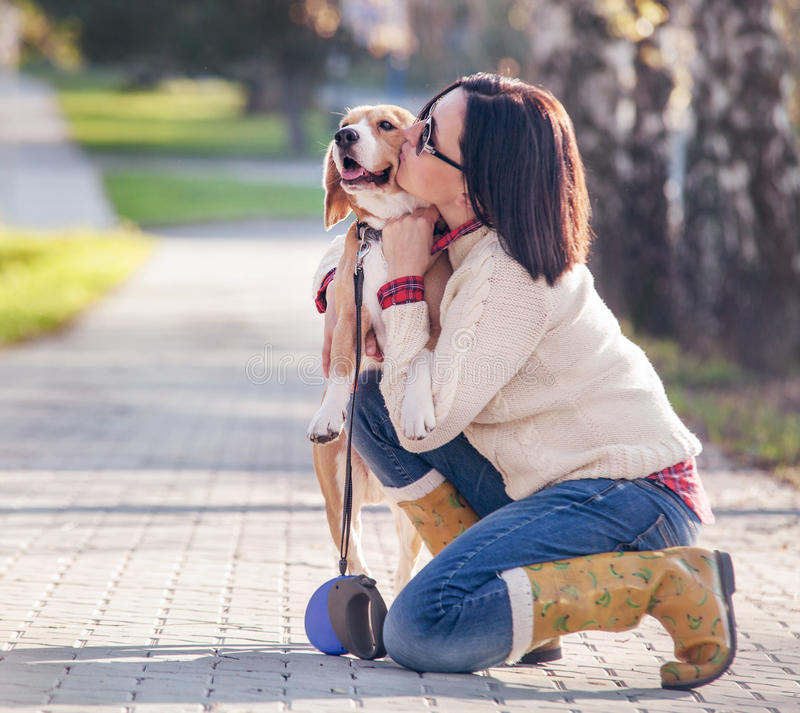 Woman hugs her favorite pet royalty free stock images