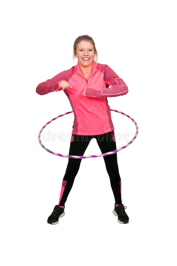 Woman with Hula Hoop. Young beautiful woman with a hula hoop royalty free stock image