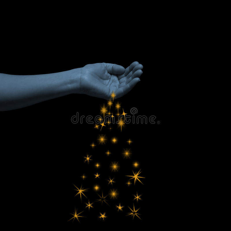 Woman human spilling out of hand yellow bright sparkly stars on black background.  stock photography