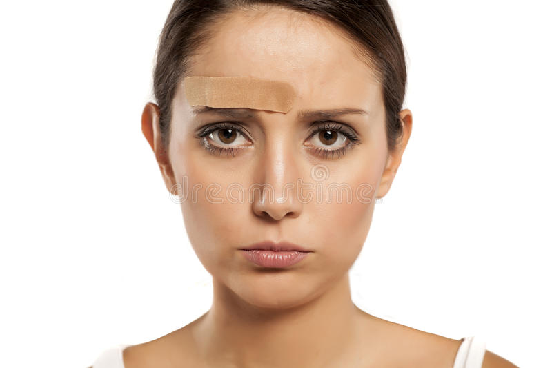 Woman with hurt face stock photo