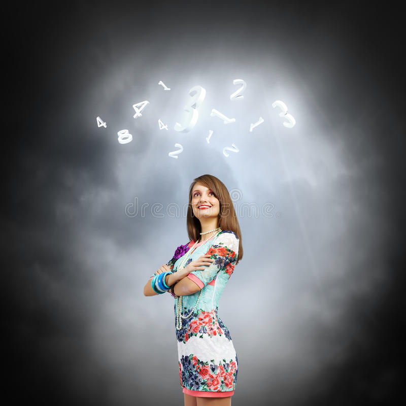 Woman i. Young pretty woman standing under sun lights royalty free stock photography