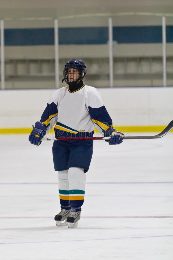 Woman ice hockey player during a game. Female ice hockey player during a game in an arena royalty free stock images