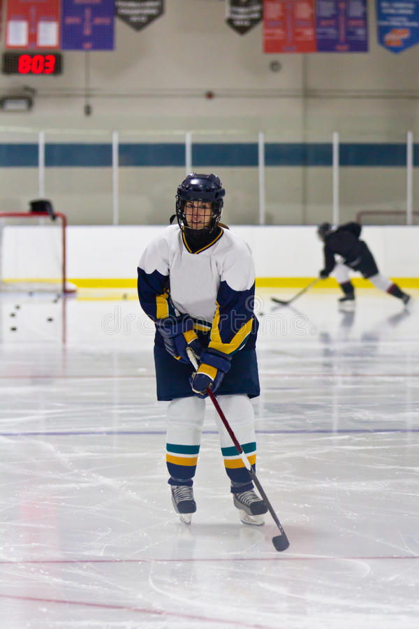 Woman ice hockey player during a game royalty free stock image
