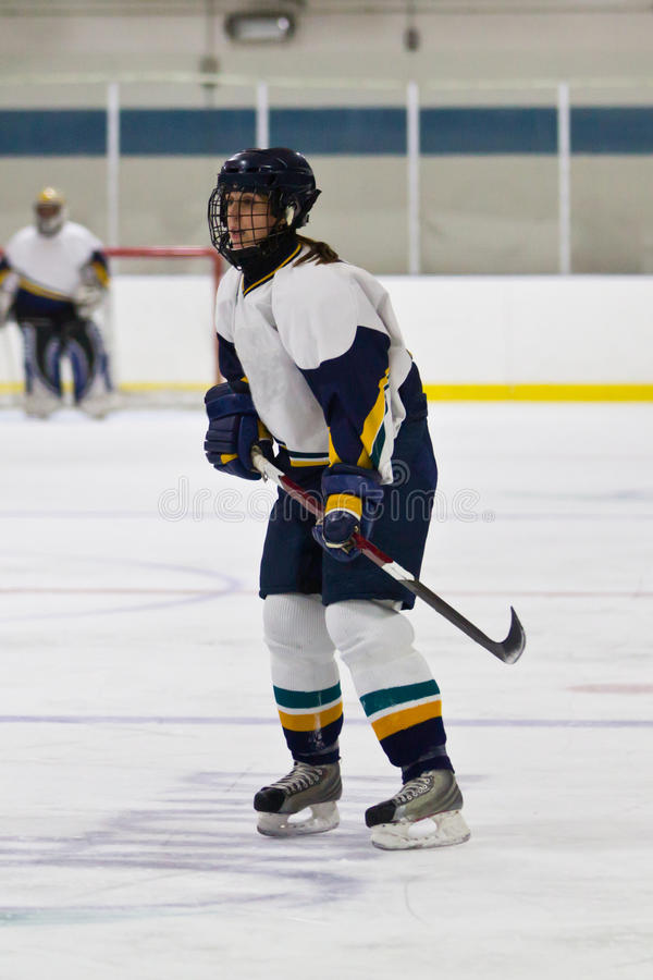 Woman ice hockey player during a game. Female ice hockey player during a game in an arena royalty free stock photo