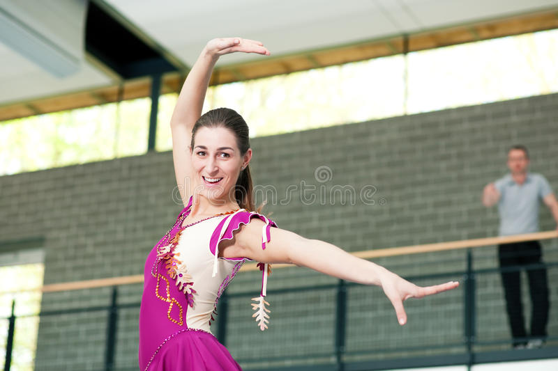 Woman ice or roller skating with coach