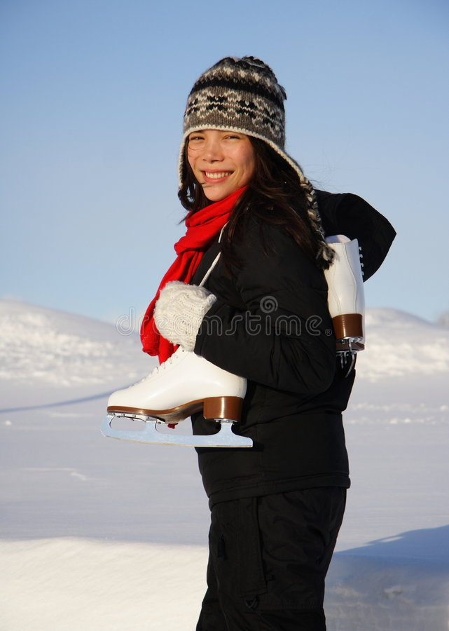 Woman with ice-skates stock images