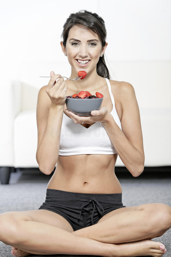 Download Woman Ieating Fruit In Fitness Clothes Royalty Free Stock Images - Image: 26822519