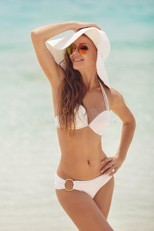 Free Woman In A White Bikini And Hat On A Tropical Beach. Stock Photography - 49820012