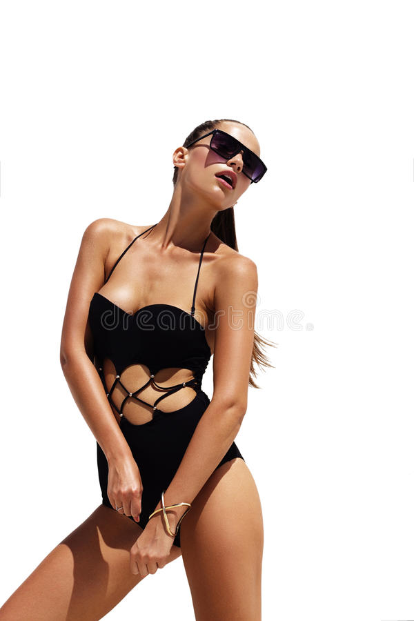 Free Woman In Black Sunglasses And Swimsuit Wearing Golden Bracelet With Hair Up Poses On Isolated White Background. Fashion Royalty Free Stock Photo - 70592915
