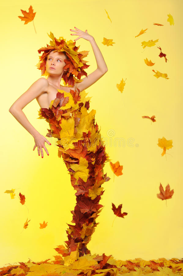 Free Woman In Dress Of Leaves And Defoliation Stock Photo - 21537210