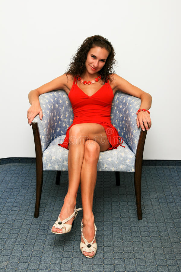Free Woman In Red Dress In Chair Royalty Free Stock Images - 14031069