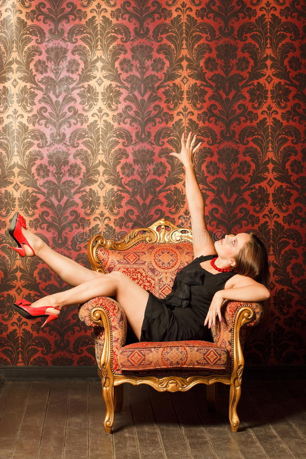 Free Woman In Red Shoes And Dress Sitting On Chair Royalty Free Stock Images - 15690639