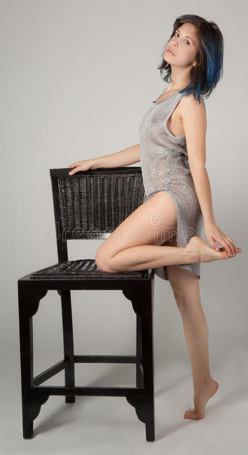 Free Woman In Sparkly Dress Leaning On Chair Royalty Free Stock Images - 70459559