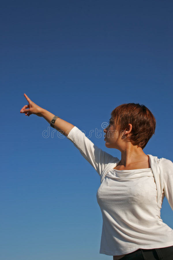 Woman indicating the sky royalty free stock photo