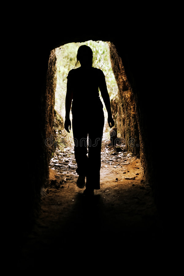 Woman inside cave royalty free stock photo