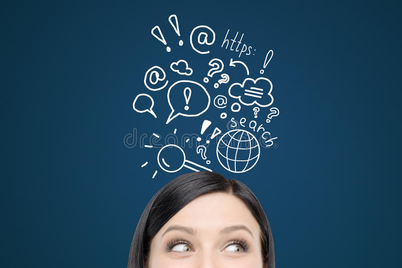 Woman with internet search sketches on dark blue wall royalty free stock photo