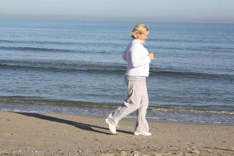 Download Woman involved in sports stock photo. Image of seashore - 22362822