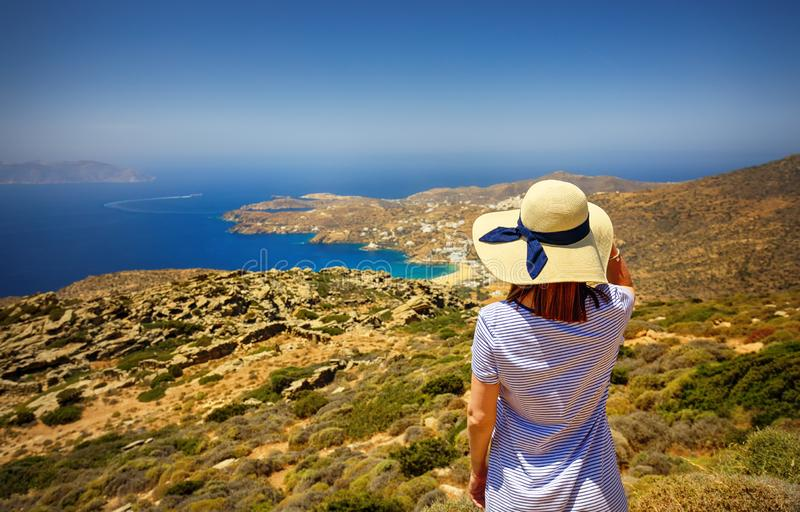 Woman in Ios Island, Greece, Cyclandes on the top of the road stock image
