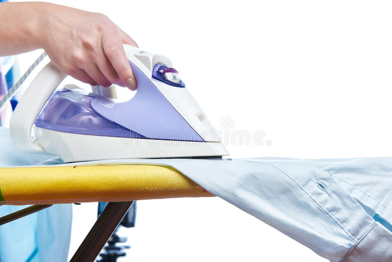 Woman ironed shirt. On the ironing board isolated royalty free stock photos