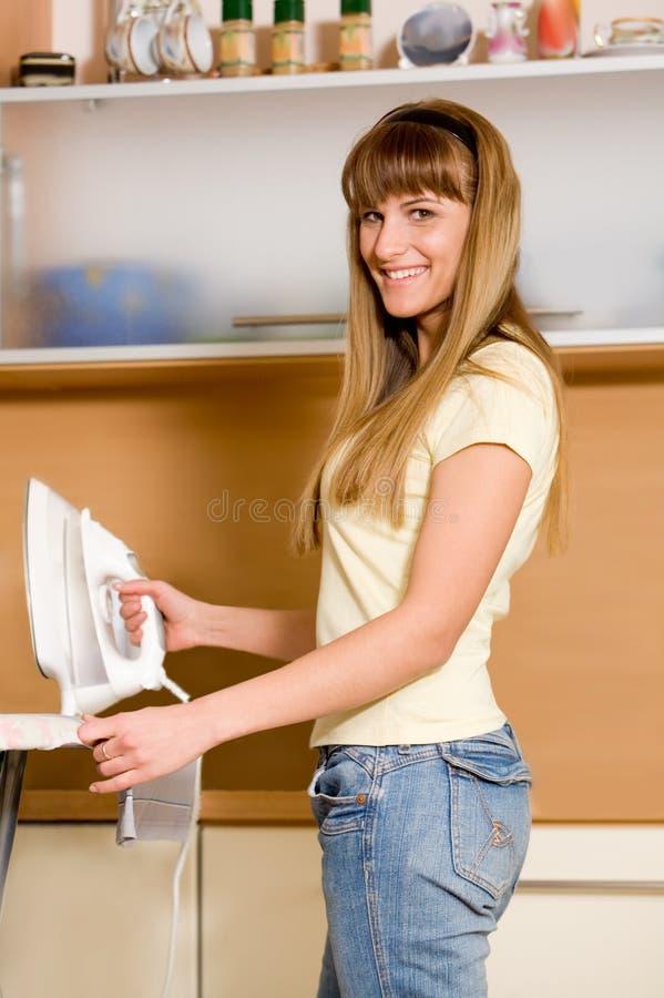 Woman ironing royalty free stock photography